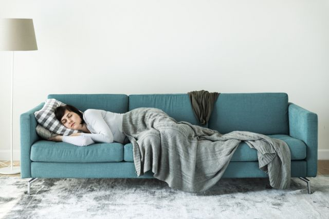 woman sleeping on couch recovering from oral surgery - Cal Oral Surgery stockton, CA