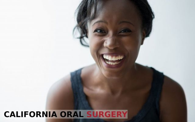 African American woman with a healthy smile enjoying the benefits of smiling - Stockton, CA