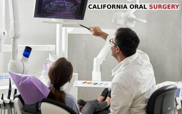 Dentist showing X-Rays to patient who often visits the dentist - California Oral Surgery