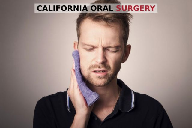 Man holding face in pain because of a facial trauma - Stockton, CA